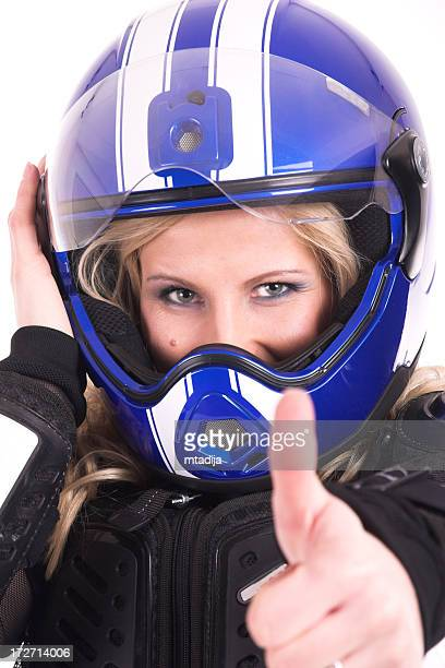Young beautiful woman in motoracer uniform