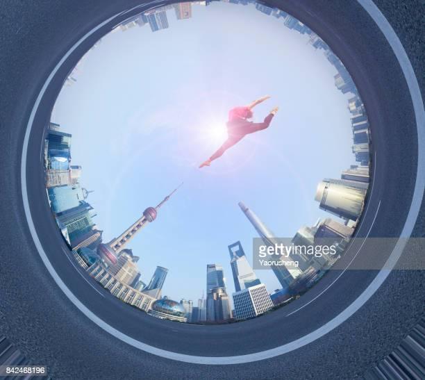 Young beautiful woman jumping at Shanghai bund,China