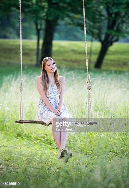 Young Beautiful Woman On A Swing