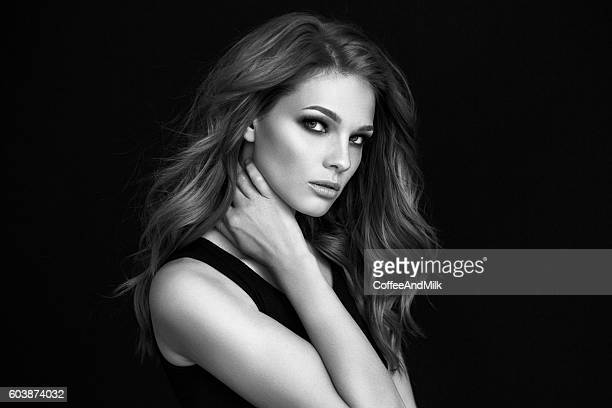 Young beautiful woman on dark background