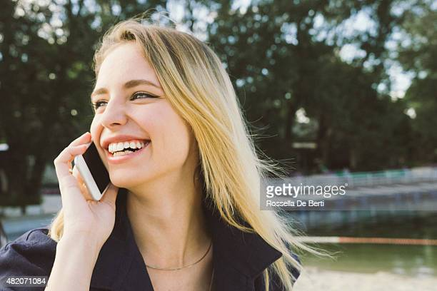 Young Beautiful Woman On The Phone At The Park