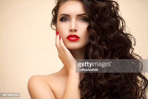 Young beautiful woman. Professional make up and hair style