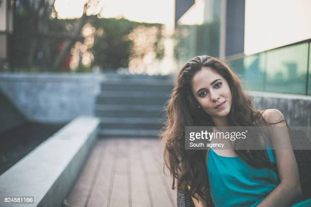 Young beautiful woman relaxing on deck chair