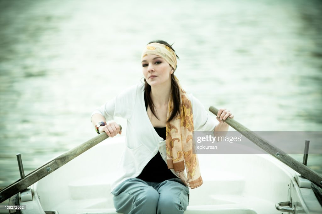 Young Woman alone in a Rowboat : Stock Photo