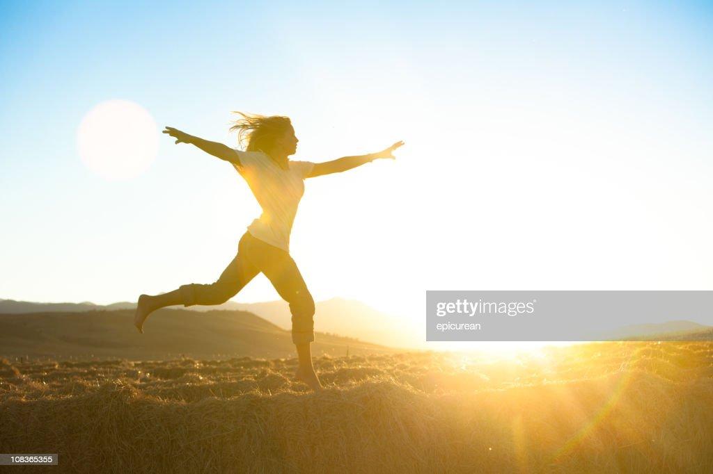 Young beautiful woman running barefoot : Stock Photo