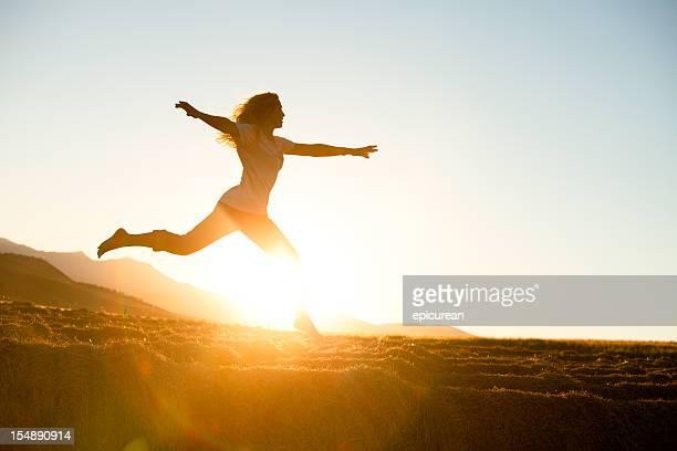 Young beautiful woman running barefoot