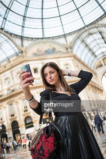 Young beautiful woman taking selfie in Galleria Vittorio Emanuele, Milan