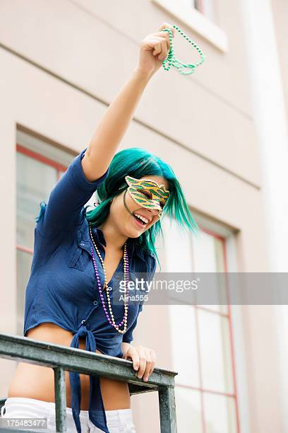 Young beautiful woman wearing mask in New Orleans