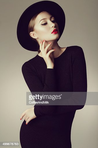 Young beautiful woman wearing retro hat