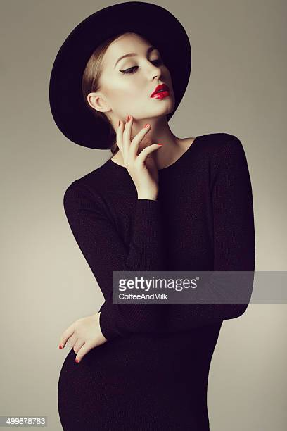 Young beautiful woman wearing retro hat