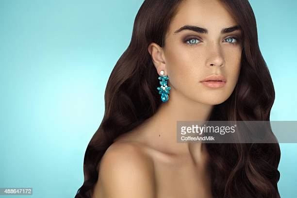 Young beautiful woman with earings