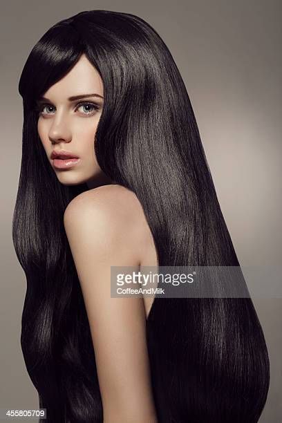 Young beautiful woman with luxury hair