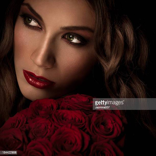 Young beautiful woman with red roses