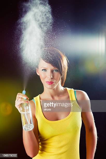 Young beautiful woman with spray bottle