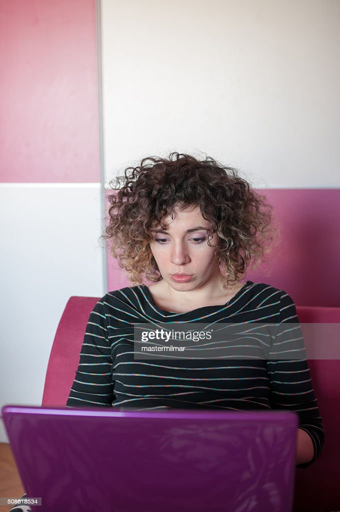 Young beautiful woman working on laptop In bedroom : Stock Photo