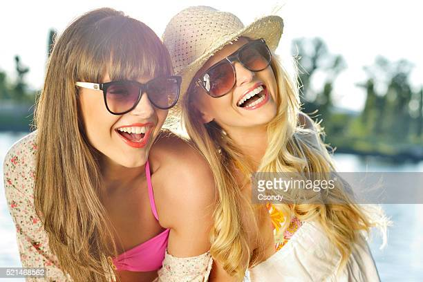 Young beautiful women laughing together
