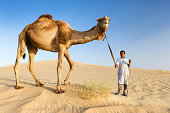 Young bedouin with camel on Western Sahara Desert in Africa