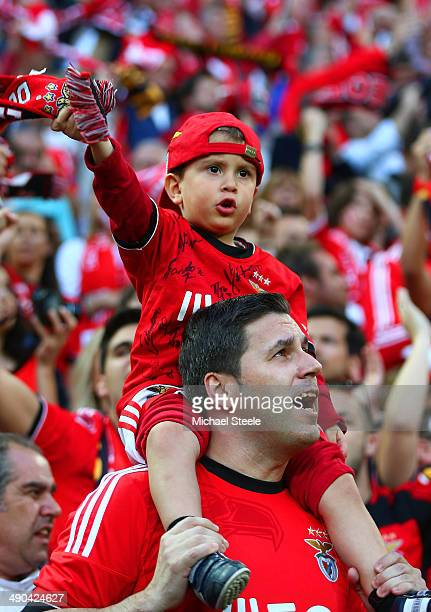 A young Benfica fan sings in the stands prior to the UEFA Europa League Final match between Sevilla FC and SL Benfica at Juventus Stadium on May 14...