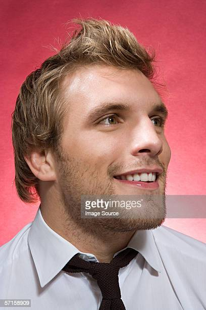 Young bestubbled man smiling
