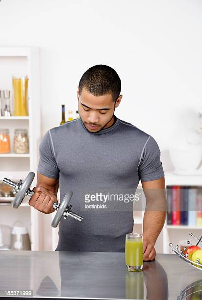 Young Biracial Adult Exercising In The Kitchen