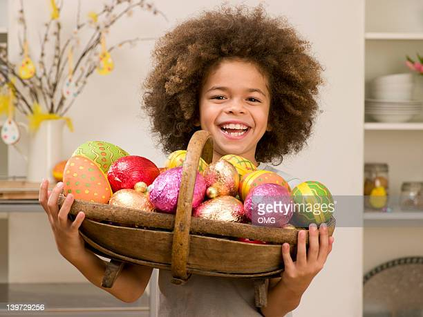 Young black boy holding a basket of Ester eggs