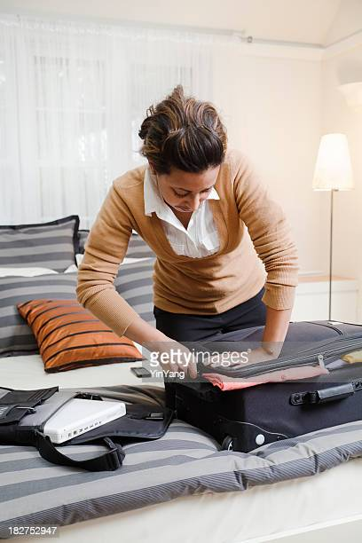 Young Black Business Woman Packing Luggage in Hotel Room Vt