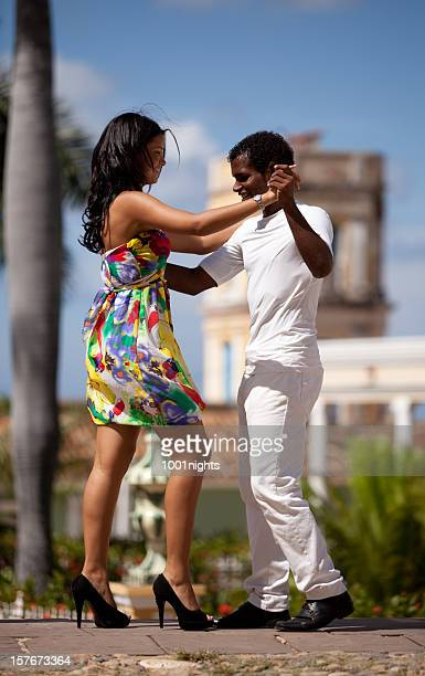 Young black couple dancing salsa
