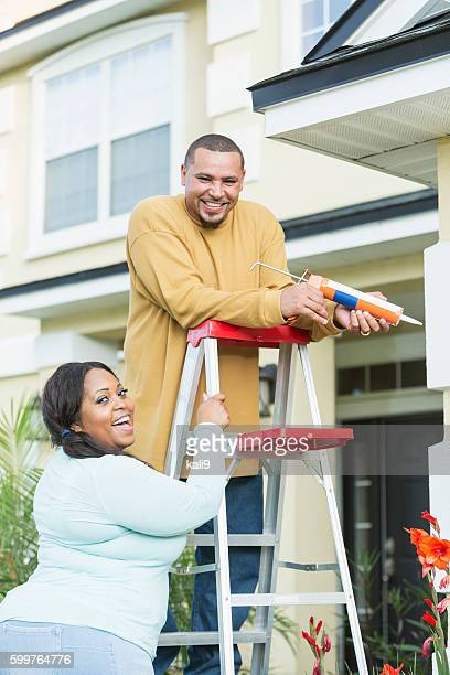 Young black couple doing home repairs