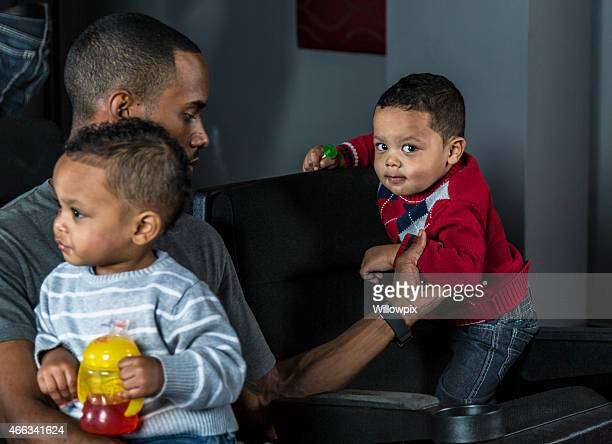 Young Black Dad Caring For Twin Sons