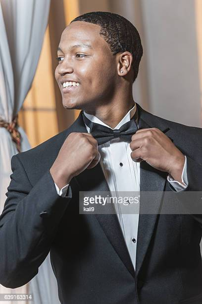 Young black Hispanic man wearing tuxedo