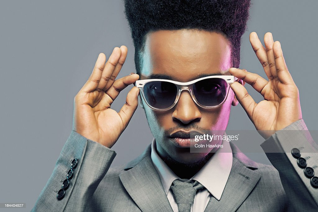 Young Black Male adjusting sunglasses : Stock Photo