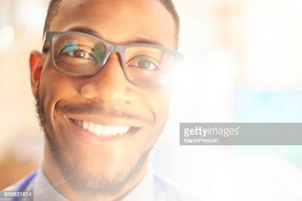 Young black male smiling and looking to camera