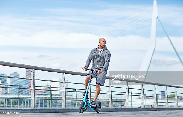Young black male using outdoor fitness device