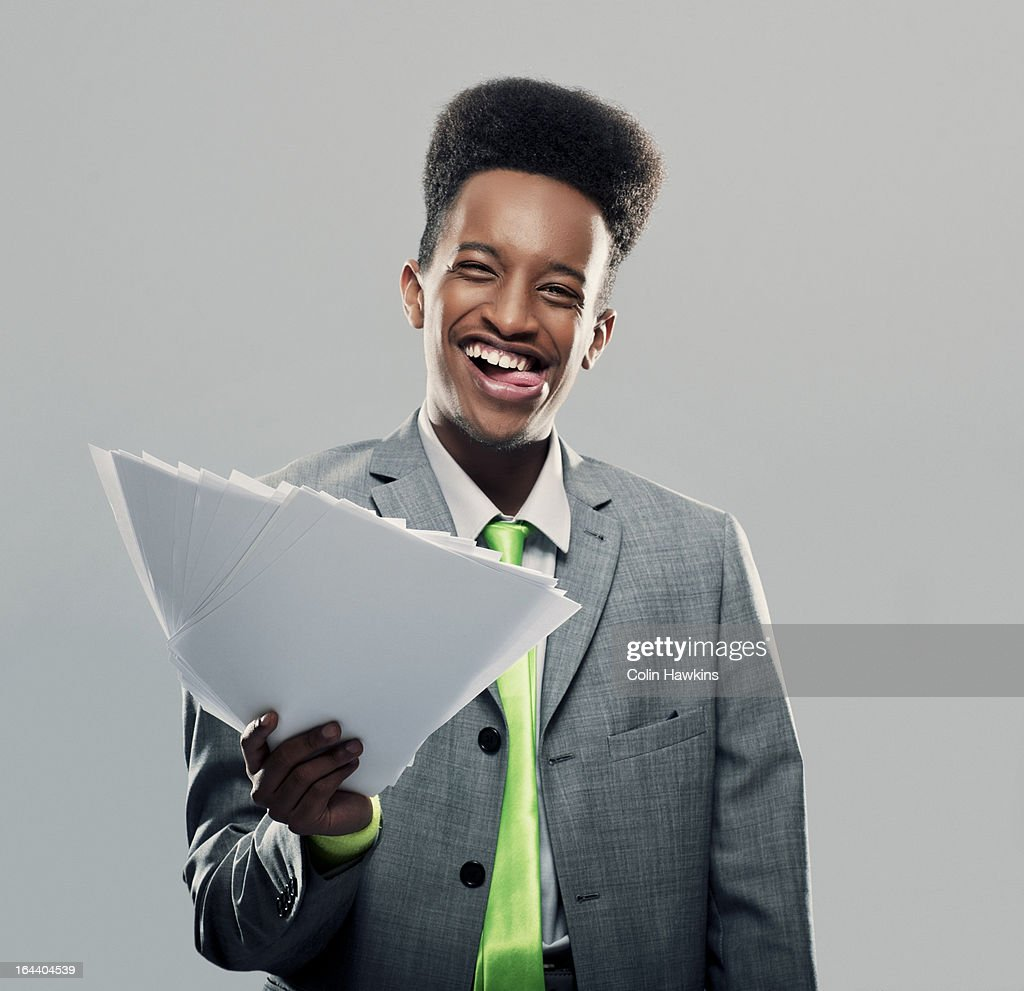 Young Black male with papers : Stock Photo