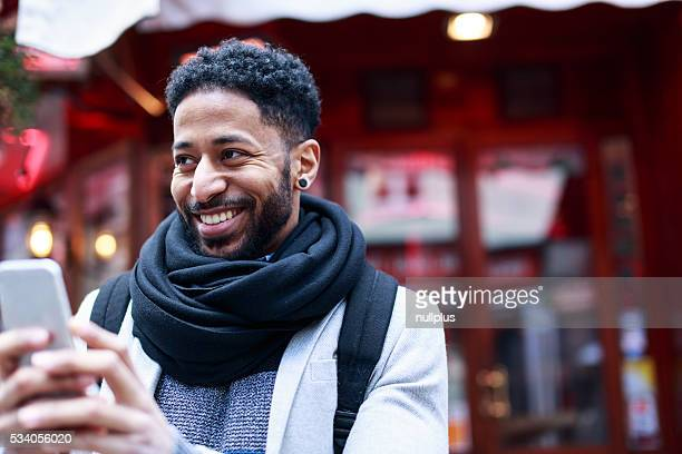 Young black man having fun in Latin Quarter