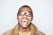 young black man with glasses smiling