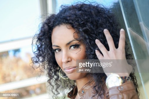 Young Black Woman Afro Hairstyle In Urban Background Stock Photo