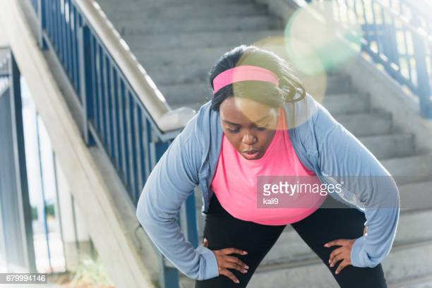 Young black woman in city, exercising