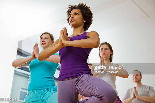 Young black woman leading a Yoga class
