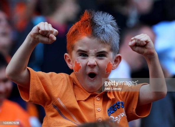 A young Blackpool fan celebrates at the end of the Barclays Premier League match between Wigan Athletic and Blackpool at the DW Stadium on August 14...