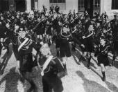 Young Blackshirts are to provide a display of Italian Fascist youth for the British Prime Minister Neville Chamberlain and Foreign Secretary Lord...