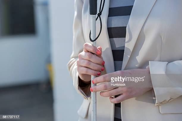 Young blind woman with her cane