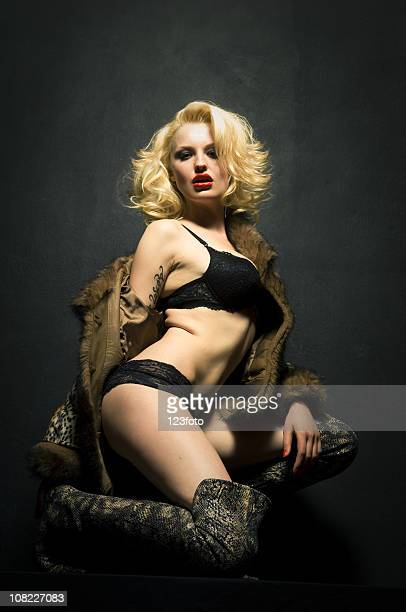 Young Blond Woman Kneeling and Posing Wearing Lingerie