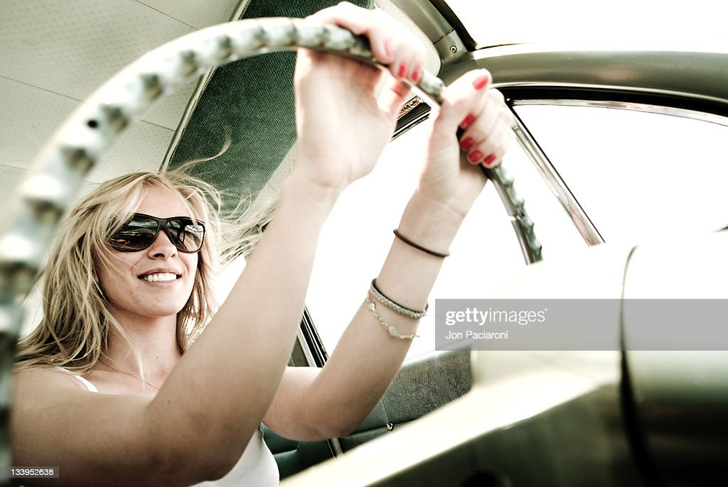 Young blond woman smiling : Stock Photo