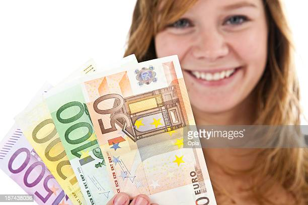 Young blond woman with euro notes