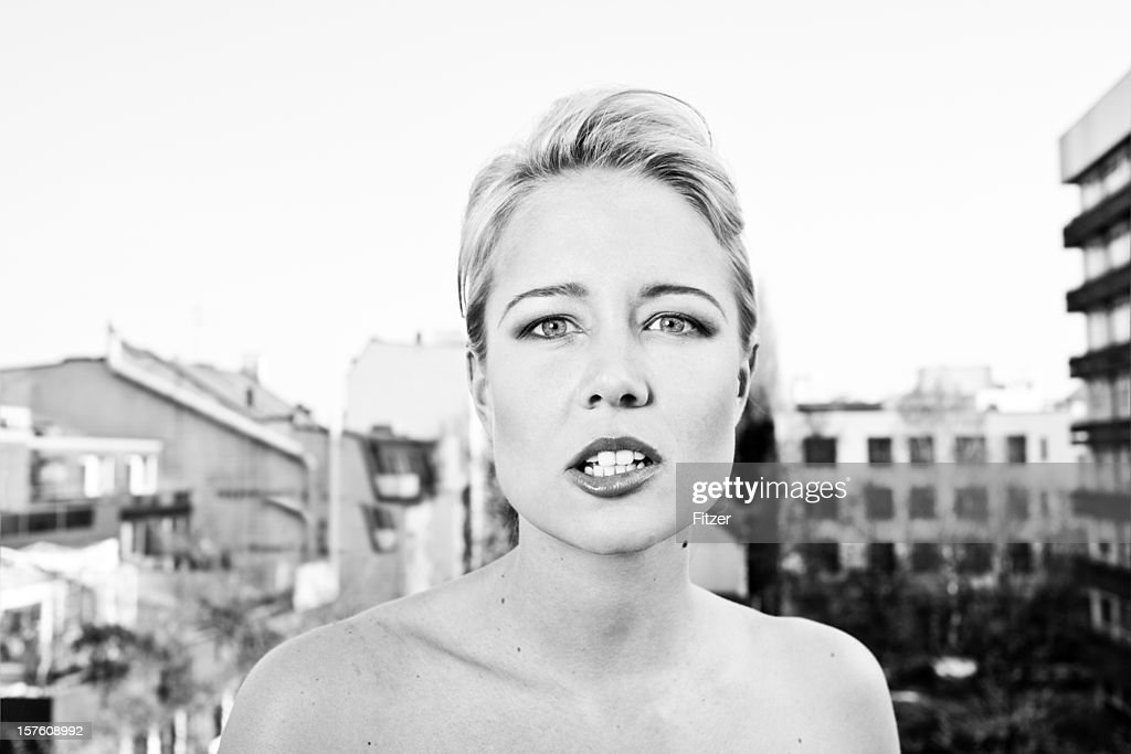 young blonde candid woman outdoor, black and white : Stock Photo
