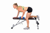 Young Blonde Female Exercising on Weight Bench