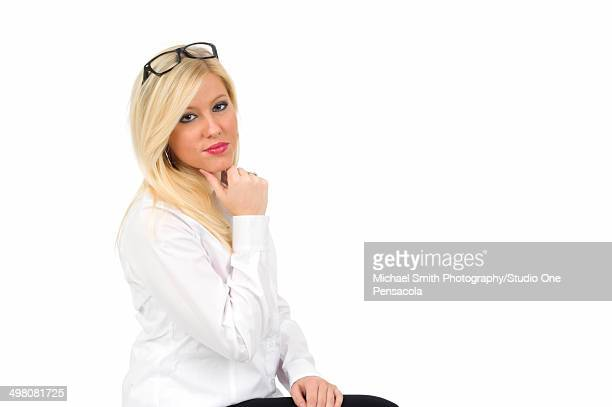 Young blonde sexy office worker wearing glasses
