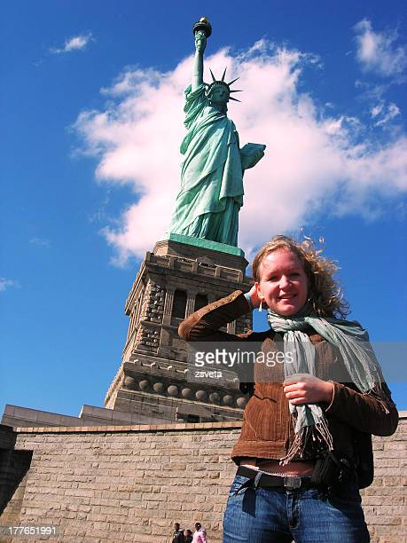 Young blonde woman at Statue of Liberty