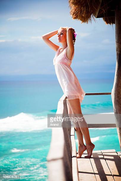 young blonde woman by sea